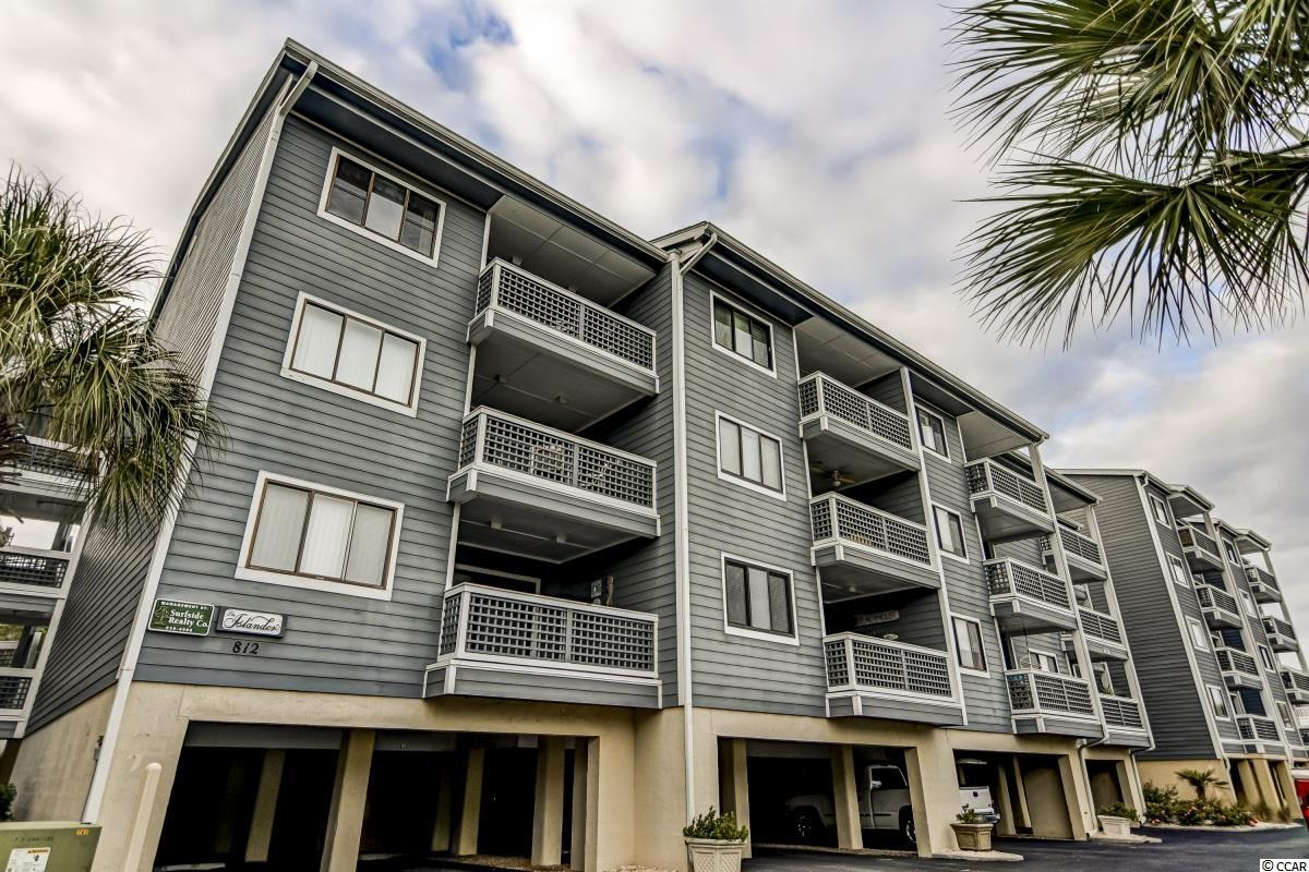 """Fabulous 2 bedroom 2 bath ocean view, second row from the beach, condo in The Islander of Surfside! This great unit comes fully furnished and totally """"move- in ready"""" so you can start enjoying it right away, making it a perfect primary home, vacation home, or investment property! Upgraded LVP flooring runs throughout the foyer, hallway, and living room. Sliding glass doors off the living room and dining area take you out to the balcony where you can relax and enjoy the view and ocean breeze! In the kitchen you will find full size stainless steel appliances including a fridge and dishwasher, as well as white subway tile backsplash, tile floors, a breakfast bar, and tons of cabinet space! The dining area is generously sized with a table that can seat 6 plus there is additional seating at the breakfast bar. The master bedroom has a king sized bed, a ceiling fan, and a private bath with a shower/tub combo.The second bedroom has 2 double beds, a ceiling fan, and direct access to the second full bath also with a shower tub combo. This splendid unit is located in The Islander of Surfside Beach, which offers a community pool and is just across the street from the ocean yet still close enough to restaurants, shopping, and entertainment! Come see this wonderful condo today!"""