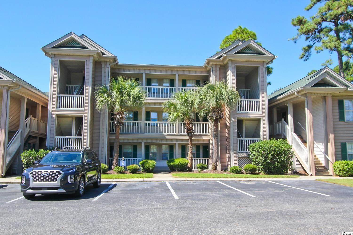 Desirable 2 BR 2 BA, 1st floor furnished unit with panoramic views of lake located on a par 3 #16 at True Blue in Pawleys Island.  Screened porch is accessible from both the main living area and the master bedroom.  Each unit has a outside storage closet.  HVAC updated in 2017.  The True Blue Community is a beautiful place to live, vacation, or invest.  Amenities include swimming pools, hot tubs, tennis courts and a clubhouse with a restaurant serving breakfast and lunch.  Owners enjoy reduced golf rates.  True Blue is located near shopping, restaurants, and the beaches too!