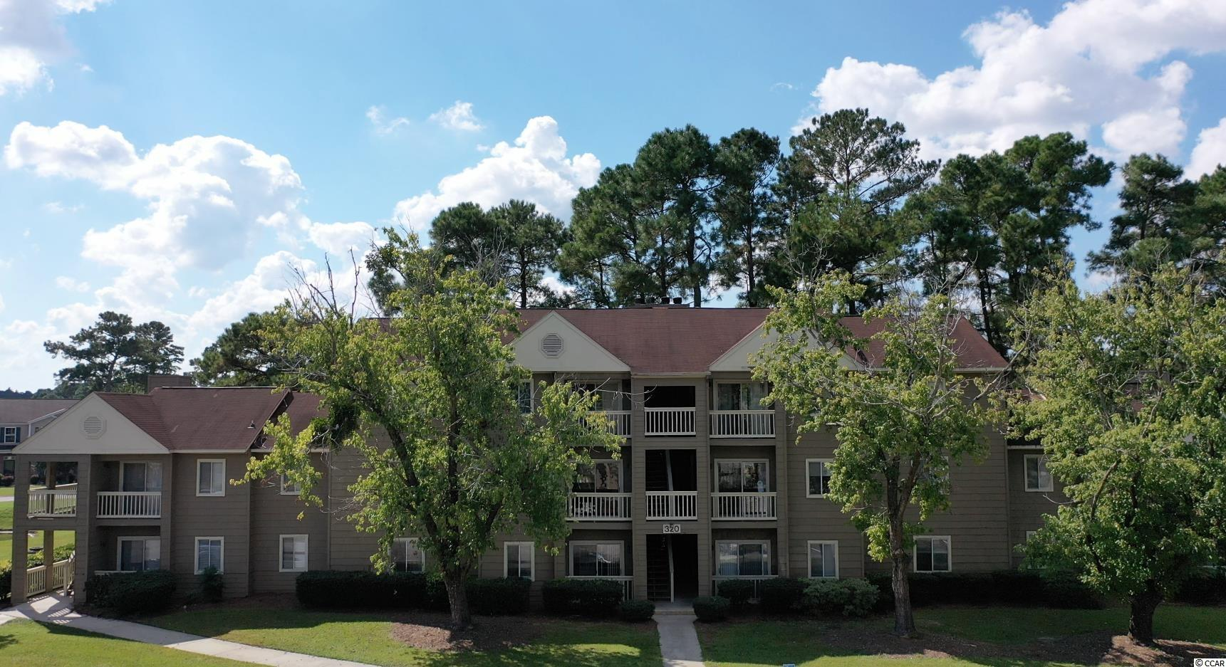 This welcoming 1st floor 2 bedroom 2 bath condo could be a gem you have been looking for. This piece of paradise is located in the popular Myrtle Greens community and will provide you with warm memories of your time here at the beach. Let's begin with LVP wood flooring, classic living/dining room combo that showcases a sliding glass door that opens up the relaxing balcony. The updated kitchen is equipped with new cabinets, granite counter tops, and a stainless steel appliance package. The master bedroom offers a walk-in closet with custom shelving, private access to the master bath featuring a new single sink vanity, a comfort station, and a timeless tub/shower combo. The delightful condo is completed with an additional bedroom with access to the full guest bath, and a practical laundry closet. This condo affords you easy access to the beach and golfing along with all of the other activities and happenings in Myrtle Beach & Conway including fun eateries, award winning off-Broadway shows, public fishing piers, Conway's historic riverwalk, and intriguing shopping adventures along the Grand Strand. Conveniently located to your everyday needs, including grocery stores, banks, post offices, medical centers, doctors' offices, and pharmacies. Check out our state of the art 3-D Virtual Tour.
