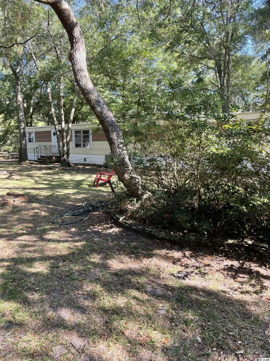 Located in Murrells Inlet on approximately 1/2 acre lot at the corner of Pee Dee Lane and LuLu Loop. Beautiful live Oaks on the property. Convenient to Murrells Inlet Marshwalk, Boat landing for the Inlet and the ICW, Brookgreen Gardens, Huntington Beach state park,.......Wonderful setting! Square footage is approximate and not guaranteed. Buyers responsible for verification.