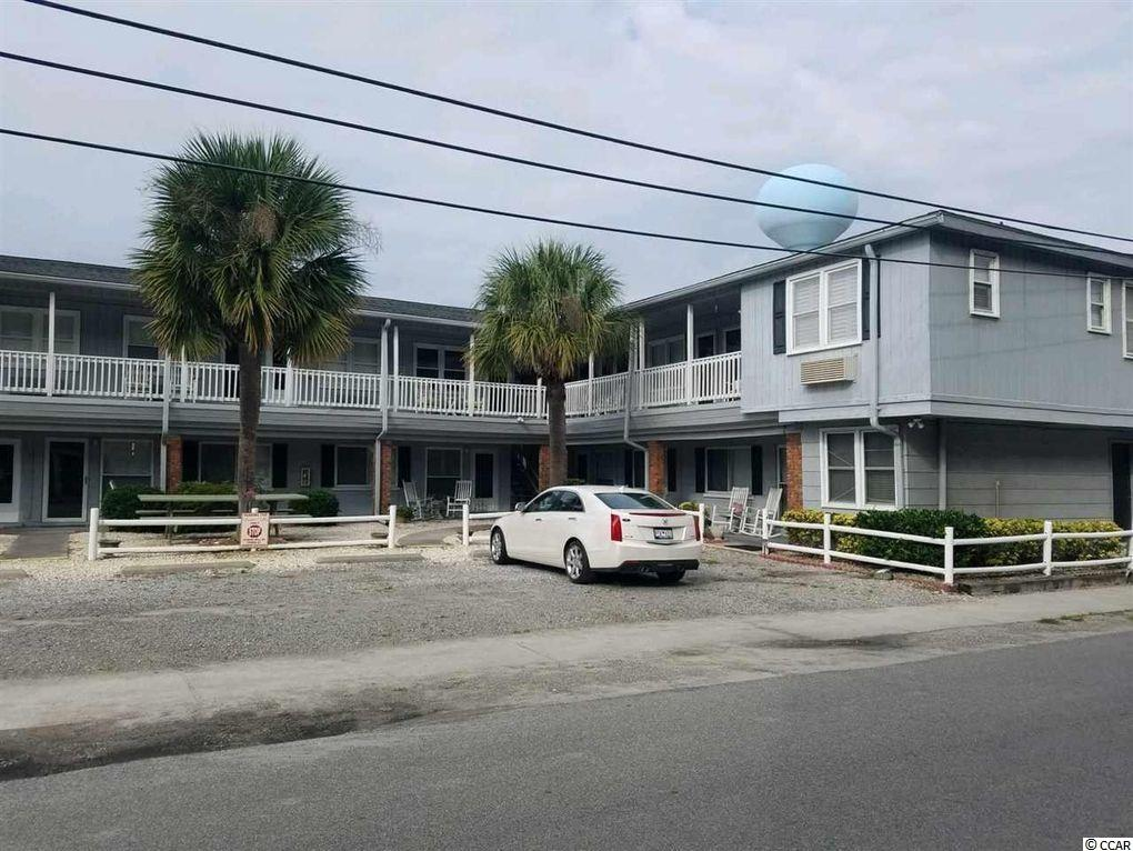 """The Perfect Beach Getaway! This efficiency, second row unit in Cherry Grove is move-in ready.  Just walk across the street and put your toes in the sand.  A short walk up the beach and enjoy Cherry Grove point!  The unit has a """"peek a view"""" of the ocean while enjoying the sea breeze and listening to the waves come ashore. The beautiful updated kitchen, with a portable workspace and storage is all you need.  The private renovated bathroom has plenty of storage and is easily accessible through a sliding barn door.  The murphy bed is simple and easy to pull down and very comfortable.  The HVAC unit is new (2021). Unit is completely furnished,  Enjoy sitting in the rockers on front porch while reading, relaxing and sipping your morning coffee or evening beverages.   Short Term and Long Term rental allowed."""