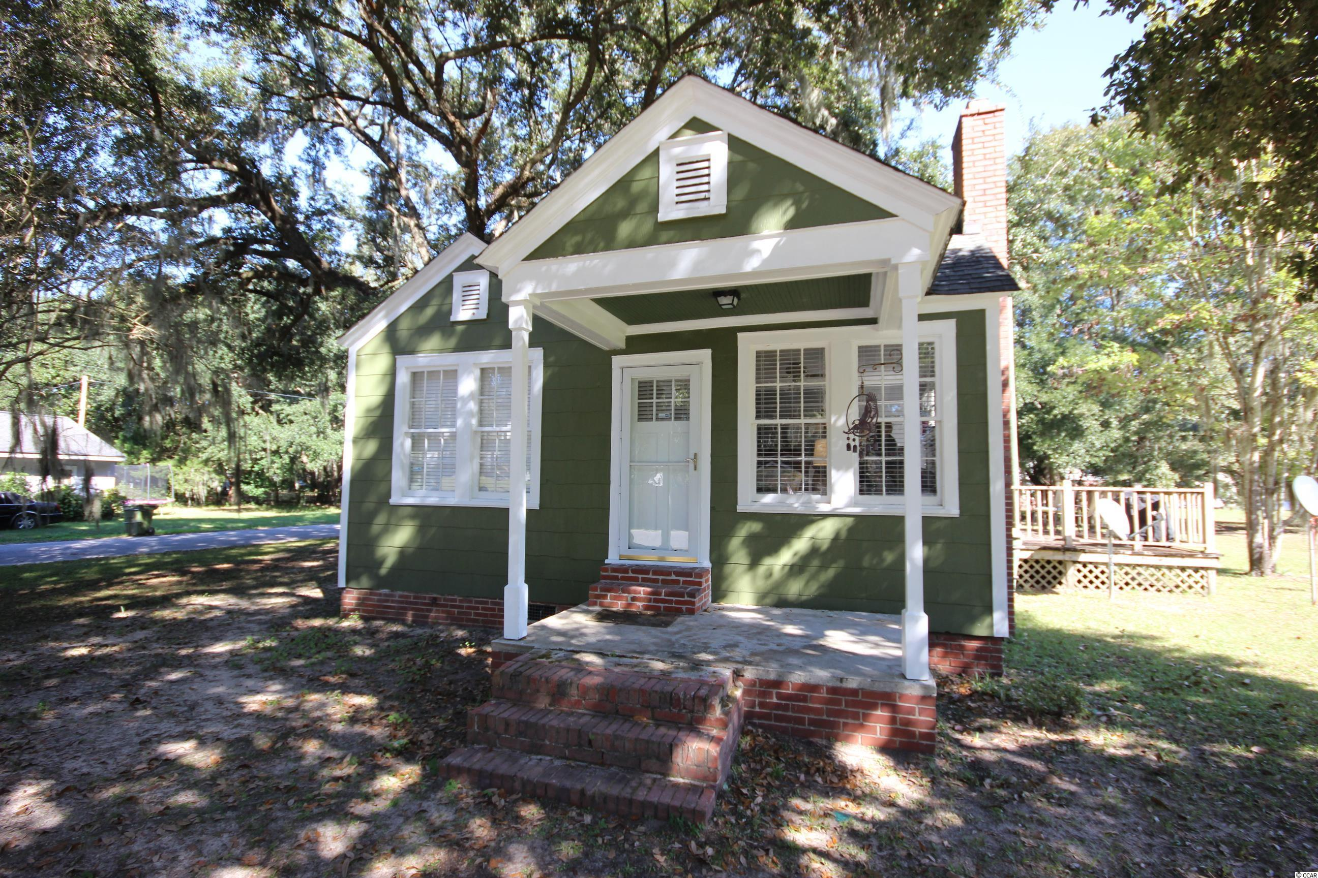 Nestled amongst gorgeous live oak trees, this neatly kept 2 Bedroom Home ~ with no HOA Fees ~ is situated directly across the street from the Bayview Park. The home offers hardwood flooring with a large deck off the kitchen and, it is bright and cheery with lots of natural light filtering in though assorted windows. Offering all one level living, with recent improvements that include an updated bathroom with a new toilet, tub and sink. All appliances convey with the sale of the home including the newer washer, dryer and refrigerator. The shed located on the property was recently painted as were both the interior and exterior of the home. Located within close proximity to both Historic Downtown Georgetown and the Harbor Walk, the home's location is convenient to all this beautiful area has to offer including an abundance of incredible restaurants, unique shops, legendary golf courses, and a large selection of water / leisure activities including boating / fishing ~ as well as miles of gorgeous ocean beach to explore and enjoy.