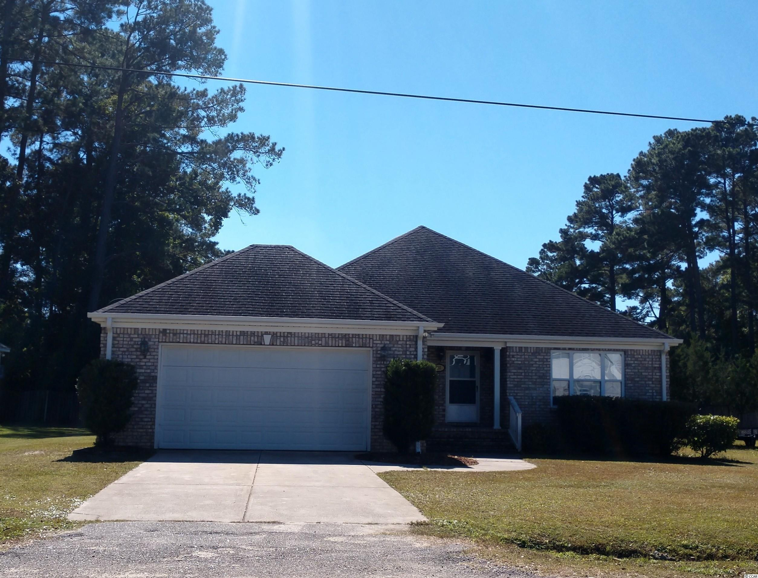 Home is ready for immediate occupancy. Large low maintenance brick and vinyl home on attractive lot with screened back porch. Interior offers large open floorplan for living area, split for bedrooms, and master has garden tub and a separate shower. This home is close to schools, hospital, dining, shopping and only a few miles to the beach. Square footage is approximate and not guaranteed. Buyer is responsible for verification.