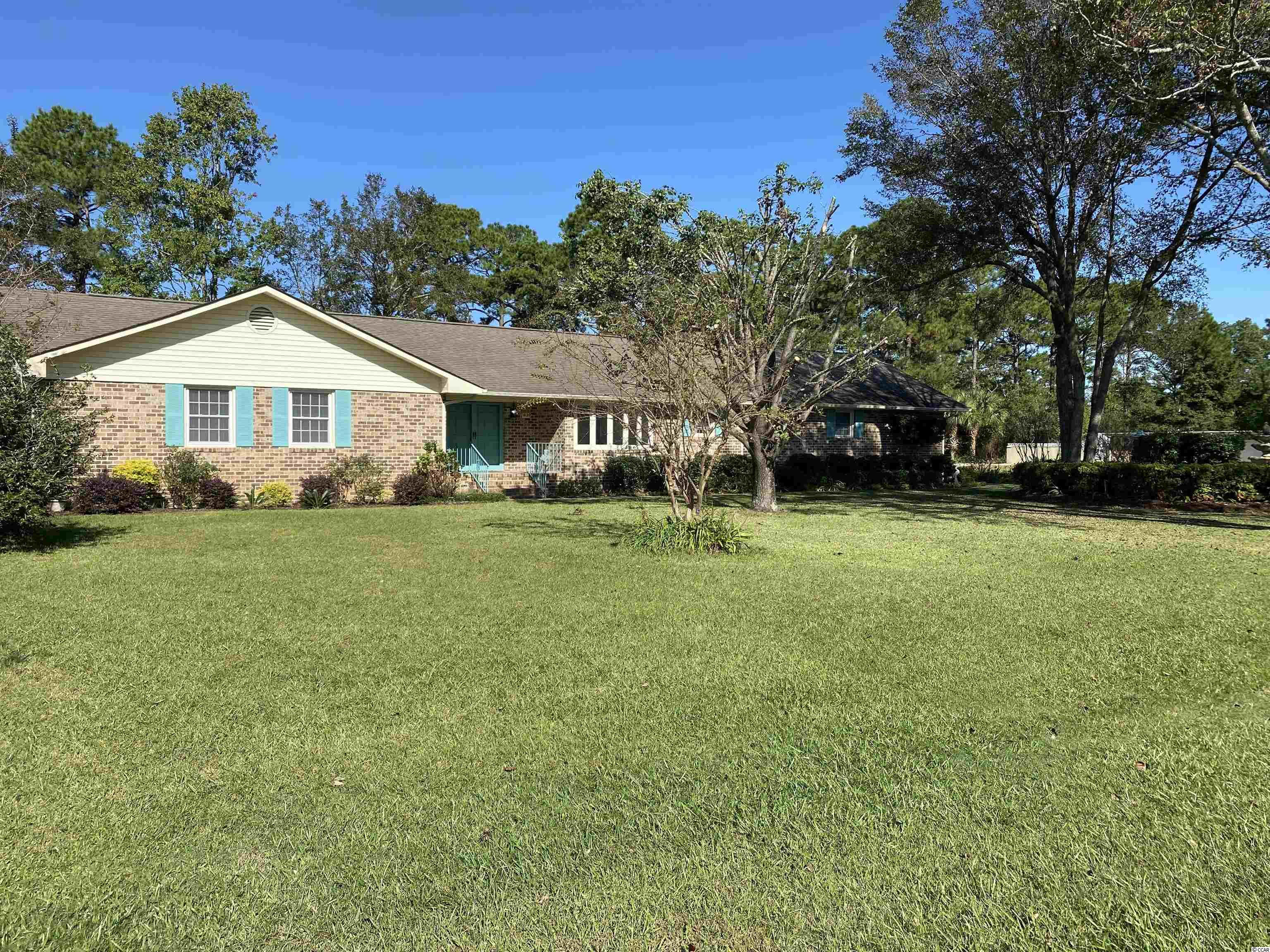 Large 3/3.5 , living room. family room. dining room, garage, workshop, den, corner lot- brick home - one mile to the ocean.  Available immediately - longterm lease.