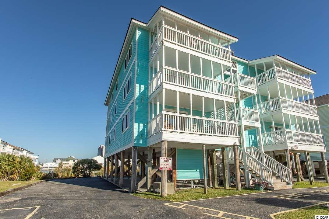 Your own pondview slice of Heaven in beautiful Cherry Grove Beach! This cozy, fully furnished 2 bedroom, 2 bath condo just steps away from the Atlantic Ocean and sits right on the Intracoastal Waterway marshes at Cherry Grove Beach. Just a short five-block walk from the iconic Cherry Grove Pier. The building a few years ago received updates, including a new roof and exterior, and a resurfaced pool deck with new fencing around the outdoor pool. More updates on the way soon. Sit and sunbathe or splash by the pool or on the beach during the days, and have cookouts at the built-in BBQ grill and picnic area in the back yard. The front and back decks are ideal for enjoying stunning South Carolina sunrises and sunsets with your morning coffee or evening cocktail. Close to dining, shopping, attractions, and all of the other wonderful things the Myrtle Beach area is known for, but outside of the busy hustle and bustle of the center of the city, Cherry Grove is truly the gem of the Grand Strand. Don't let this property pass you by. Schedule your showing today.