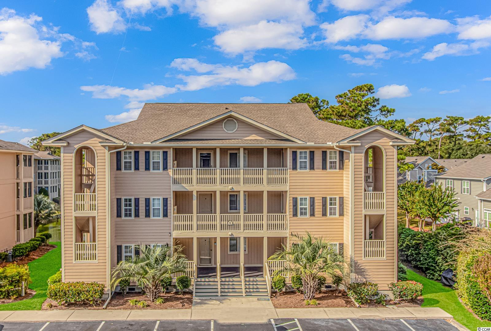Welcome home to this inviting Cherry Grove condo at Tilghman Shores Ocean and Golf Resort just 2 blocks from the beautiful sandy beach!  Enjoy your day in the sun or sit and relax on your screened porch next to the pond with golf course views beyond.  There's a separate storage room just outside the front door to store your beach chairs and toys; leave that sand outside!  The kitchen features granite counters, a pantry, and a breakfast bar and is open to the living area and screened porch beyond.  The washer and dryer, approximately 1 year old, are included along with all the furnishings you see.  The floors in the living area are hardwood, with tile in the wet areas and carpet in the bedroom.  The bathroom has been recently updated with new vanity and high rise toilet, with adorable beachy beadboard wainscoting accent.  This cozy one bedroom, one bath home can be your perfect beach getaway; it's also well suited for rental income.  This is a top floor unit with no noisy neighbors above.   Be sure to check out the large pool and hot tub, and there's a grill station and gazebo on the grounds too.  Schedule your showing today!
