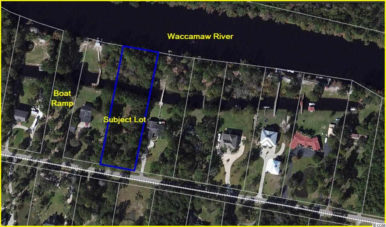 Huge Price Reduction and Possible Owner Financing! (call listing agent for details) Last undeveloped lot on the Waccamaw River on Riverside Drive.  This quiet, peaceful, neighborhood has many beautiful homes and this is 1.65 acre lot with a private canal that runs through the back third of the property so your boat won't get beat up when another boat drives by.  Rectangular in shape with approximately 150' on the river and 480' deep. Lot is partially cleared with a variety of mature trees. You are only 20 minutes from Myrtle Beach and less than two miles to downtown Conway as the crow flies!  Build your dream home or hold for an investment.  No HOA.