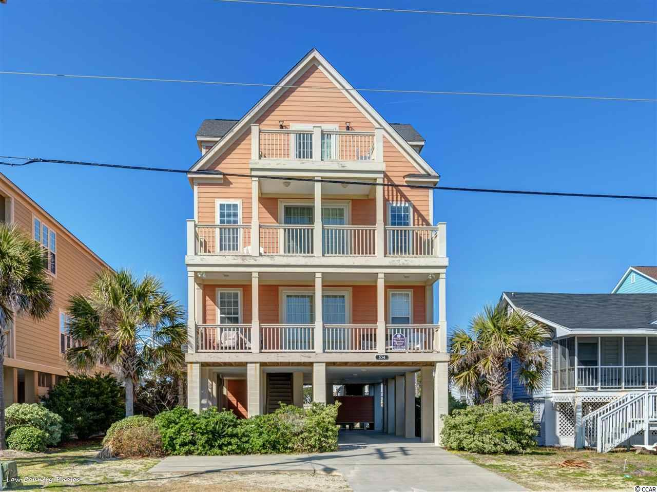 Wonderful 6br/6bth 2nd row beach house! Fully furnished and professionally decorated....Great ocean view porches! Kitchen has granite and stainless appliances. Additional family room on 2nd floor w wet bar. Great investment opportunity or second home!!!!  Great rental income!