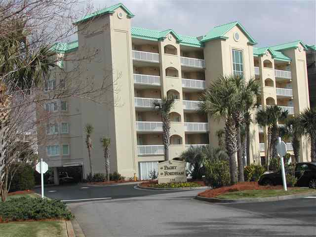 Oceanview Villa. TOP FLOOR. No footsteps from above. Freshly painted with new carpet & tile. Includes kitchen appliances & washer/dryer. This condo is in the gated community of Litchfield by the Sea with many amenities; beach, pool, jogging trails, fishing, health club & on site restaurant. Close to shopping & dining. Between Myrtle Beach & Charleston, SC.