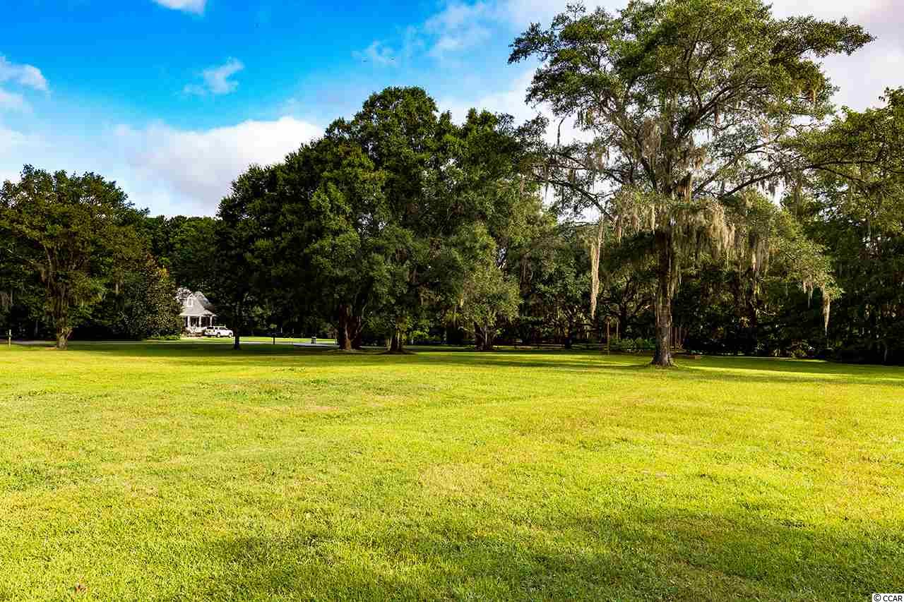 Extraordinary Waverly 1.01 acre lot with gorgeous oaks and Intracoastal Waterway access. Start building your dream house immediately on this cleared grassy corner lot within this exceptional neighborhood. Take advantage of all Pawleys Island has to offer. Boat and kayak right from your backyard with plenty of room for a pool too!  Don't miss out on this one with very few options in this most desirable neighborhood with no HOA.