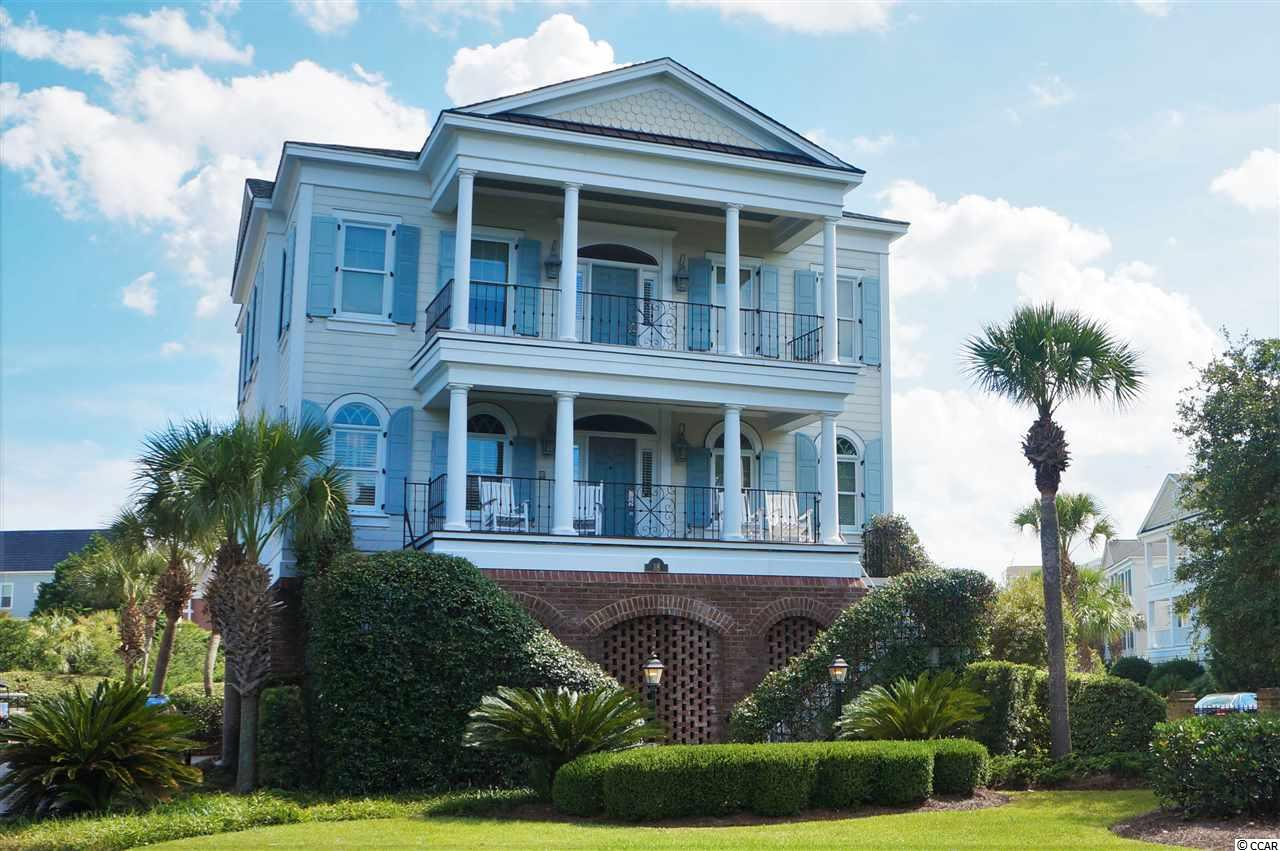 Vast Porches with Ocean and Marsh Views. Conveniently located in cul-de-sac and just steps from the beach and pool.  Large corner lot with lush landscaping. Private community beach access. Open living room with fireplace. Large dining room and large kitchen with island, eat-in bar and breakfast nook.  Large master bedroom suite with private porch and walk-in closet. Master bathroom has whirlpool tub, separate shower and dual sinks. Wet bar upstairs. Hardwood floors throughout, except bathrooms, and gorgeous crown molding. Outside living space includes four large porches; each with different views, and patio area.  Elevator, security system, outdoor shower, tank less water heater, irrigation and immense storage. Hardi-Plank siding and Ipe decking. 4-Car Garage. Community pool, tennis, exercise paths, oceanfront beach house and fishing and crabbing docks.  Just minutes to 8 world class golf courses, Harbor Club marina on the Intracoastal Waterway. 20 Minutes to Myrtle Beach International Airport. Excellent for primary residence, second home or vacation home and rental.