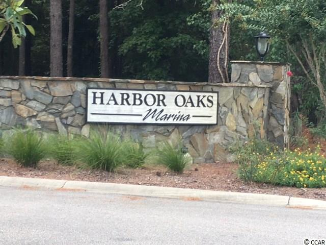 VERY NICE SINGLE FAMILY LOT IN WATERFRONT COMMUNITY ON RIVER.  LOT COMES WITH BOAT SLIP/DOCK AND BOAT HYDRO-LIFT FOR DEEP-WATER ACCESS. VERY NICE POOL AND CLUBHOUSE FOR ENTERTAINMENT OVERLOOKING THE RIVER.  LARGER LOT READY TO BUILD YOUR DREAM HOME IN GATED COMMUNITY WITH RIVER ACCESS CLOSE TO ALL MYRTLE BEACH HAS TO OFFER.