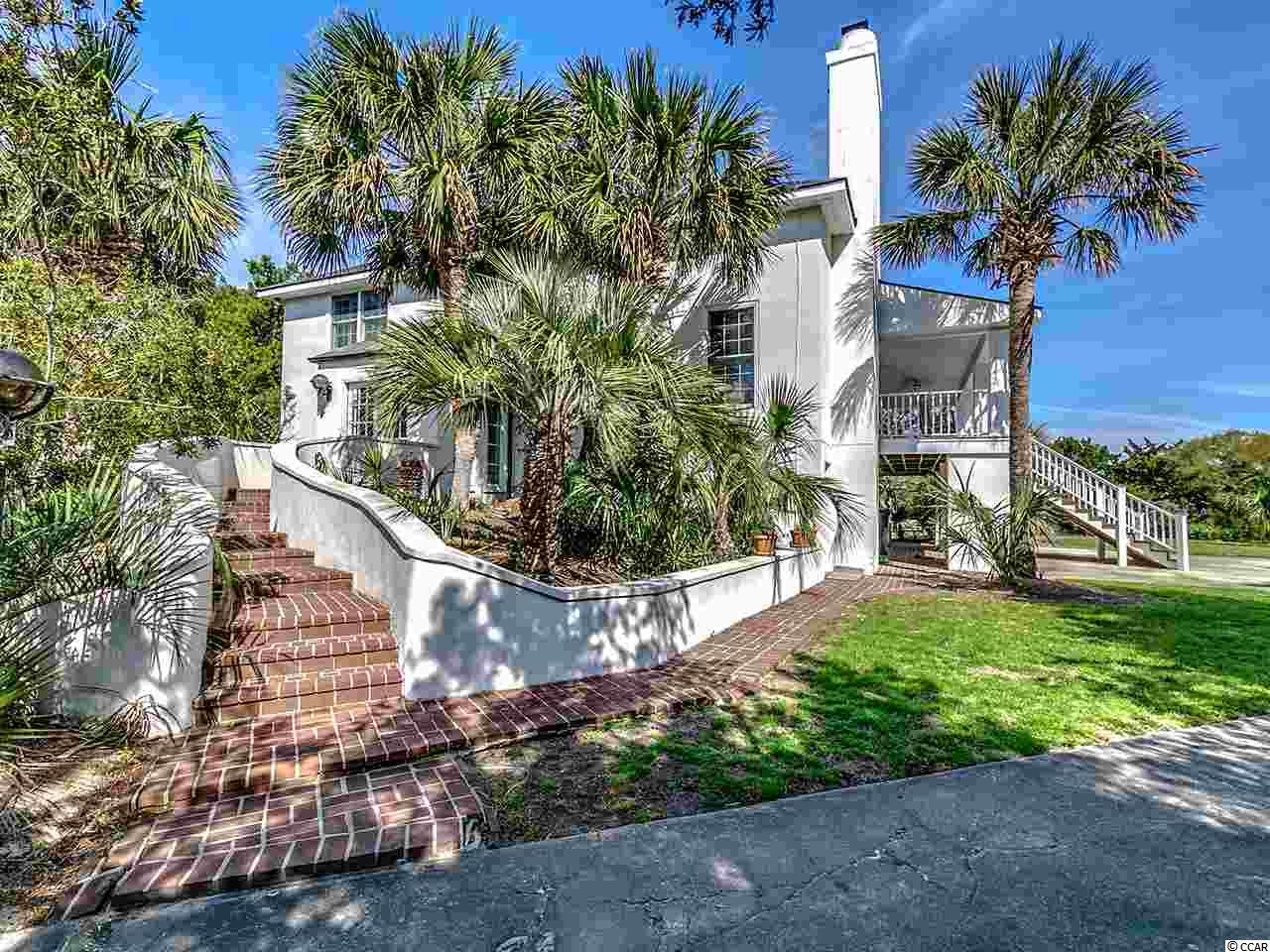 Island Community - Private 5 bedroom, 3 bath home with a great family feel on the canal and a block from the beach. This home features open living/dining room, wood burning fireplace, downstairs den/game room with both screened and open porches.  There is a crabbing dock on the canal, an outside shower and plenty of storage space for all of your beach toys.  DeBordieu Colony is a very private, oceanfront gated community located near Pawleys Island, South Carolina on the coast between Charleston and Myrtle Beach.