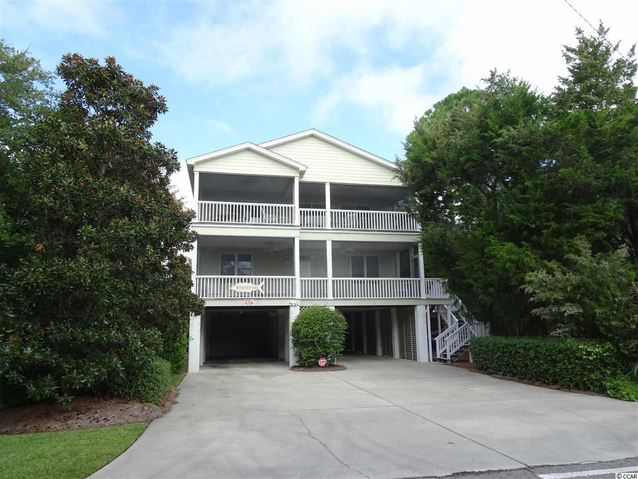 """Interval Ownership: 4 weeks per year. Enjoy four beautiful seasons of the year on the South Carolina Coast in this stunning second row beach home locally known at """"Whitefish"""". This beautiful home features 5 bedrooms and 6 full baths with an inverted floor plan allowing ocean views from the top floor living area and spacious front porch. The main living area is serviced by a 3 floor elevator and features a large open living space with fireplace flanked by a lovely dining area, recently updated kitchen, den/game room, spacious master bedroom suite and a screened porch for wonderful outdoor living. The second, lower level features 4 bedrooms each with a private bath, laundry room with personal lockers, a large rec room and another spacious front porch. The home features beautiful, comfortable furnishings throughout, heart of pine floors in the living areas, and whitewashed pecky cypress paneling. Ample parking and storage underneath along with outdoor showers. Beach access is just across the street. No pets, no smoking but rental allowed. All contracts subject First Right of Refusal to current owners.  Come enjoy all the beauty and life style of Whitefish and North Litchfield Beach...at a fraction of the cost!"""