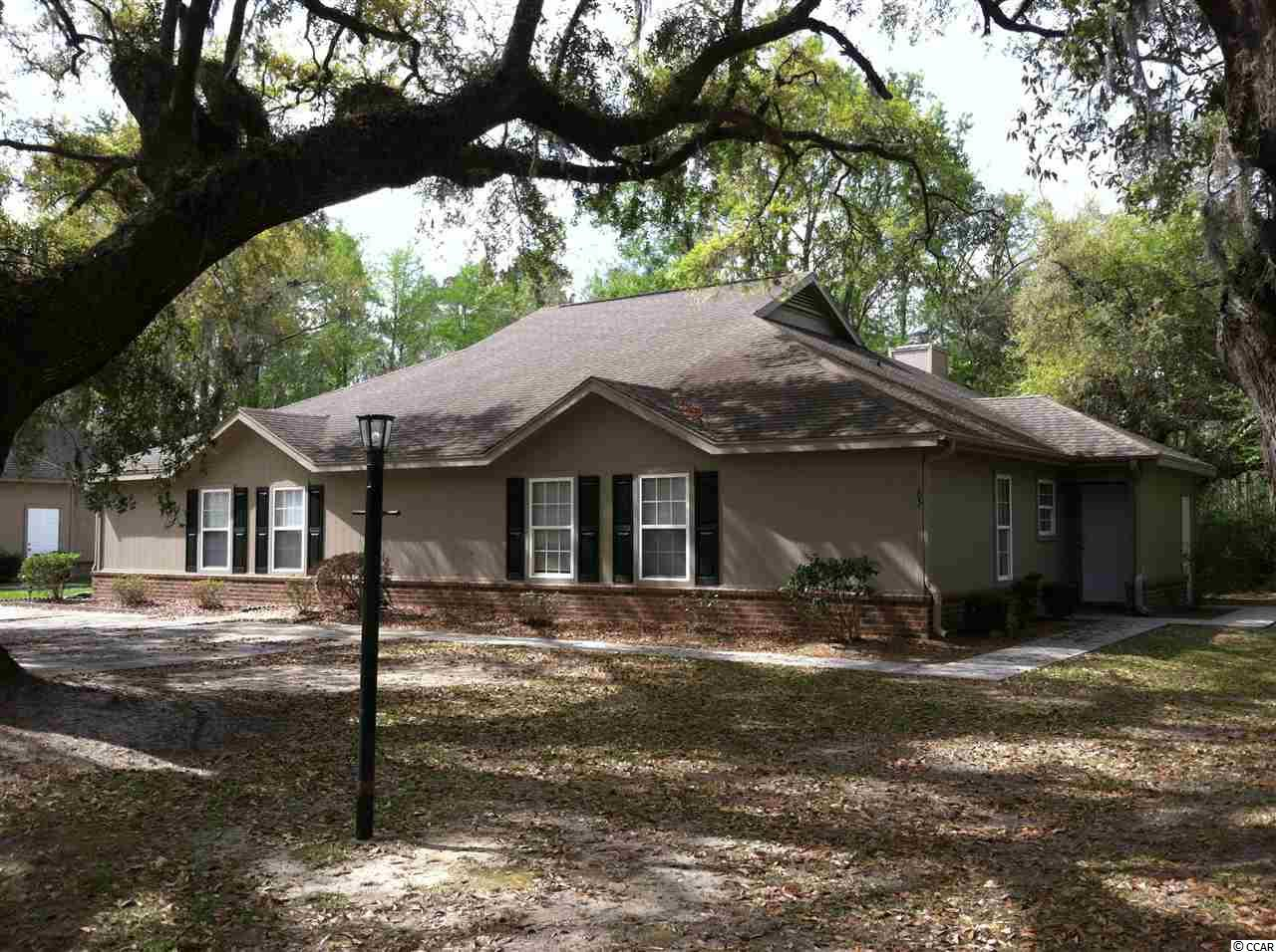 Spacious one level condo with ceramic tile floors and a fireplace.  Set on a beautiful oak lot and has a back screened area.  Square footage is approximate and not guaranteed, buyer is responsible for verification.