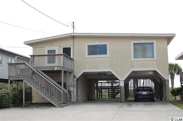 Seller is motivated and will negotiate price! OCEAN FRONT!  Great investment property!  Priced at what you would most likely pay for an ocean front lot.  Don't miss this location as you can walk to many shopping needs or use your golf cart!  Grocery store and gift shop located at the end of Sea Mountain Hwy.  Minutes to the hospital and medical offices as well as tons of shopping and restaurants. Just minutes to all golf courses and year long festivities on Main Street.  The Arcade is near by with activities for children! This is a 5 bedroom 3 bath home with a 1BR/1BA downstairs which can be used privately from the other 4BR/2BA upstairs. This property is on a rental management program company with  a great rental history! Cherry Grove Beach is a highly sought after area in North Myrtle Beach with easy access to major highways coming in to the beach. Call for an appointment today!  Square footage is approximate and not guaranteed.  Buyer is responsible for verification.