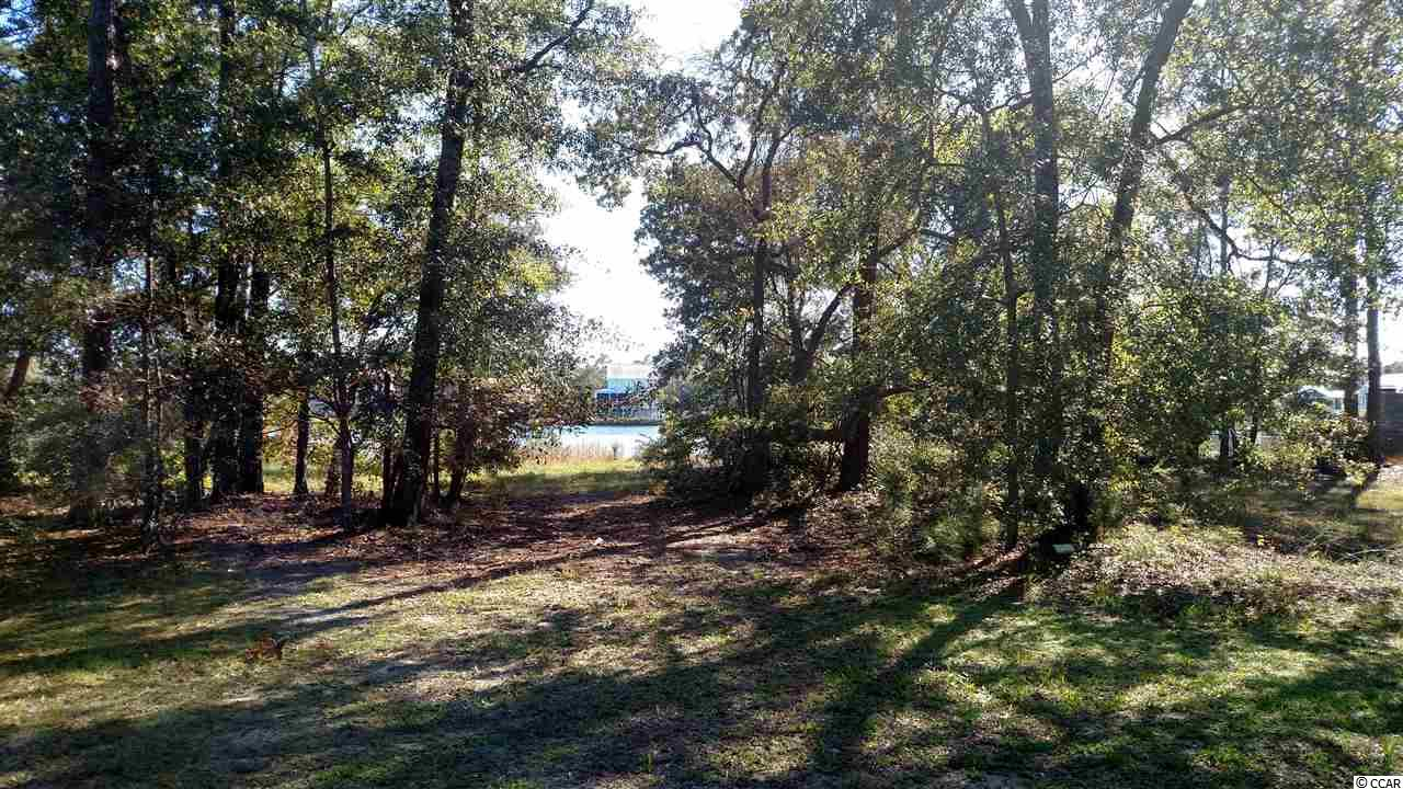 Imagine building your dream home on the beautiful lot looking out over this 20 acre lake. Gated community, requires access code for entry.