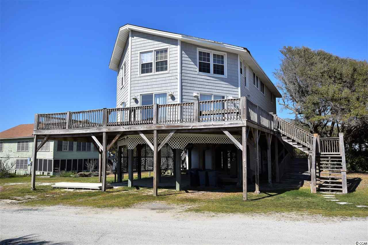 PRICE REDUCED! Pawleys Island Beach. 6 Bedroom/ 3 Bath Raised Beach House on the East Side of Myrtle Ave.  Lot In the Creek (with Dock Permit) conveys with the House.  Views of the Creek from the Open Family Room.  Access to the Beach and the Blue Atlantic. Easement Beach Access. Two story w/ Carolina Room on 1st Floor w/ Creek Views & Family Room on 2nd Floor with Creek Views.   Ocean Views from the wrap around Porch.  Build your own Dock & fish, crab & boat in the creek.  Close to Shopping, Dining & Golf.  Rental History Available. Built 1974.