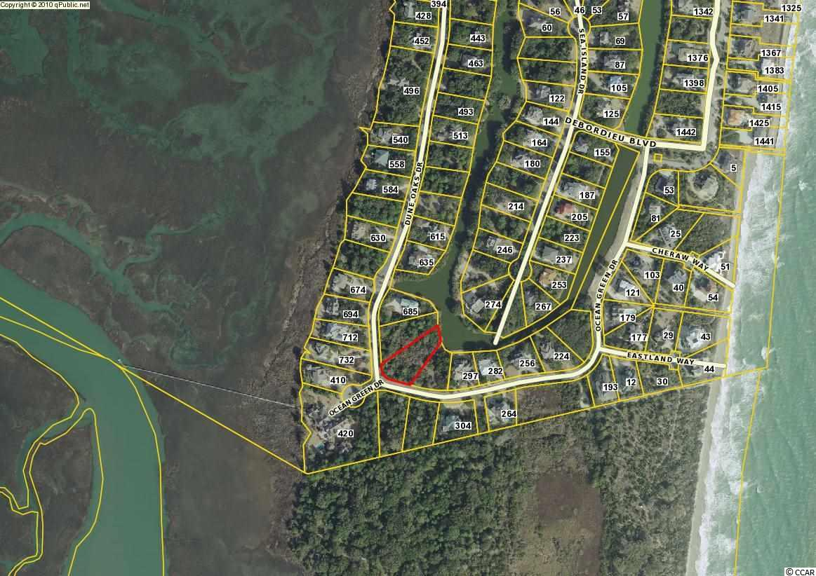 """Island Community - Large (nearly a full acre), lakefront homesite with the potential for marsh/creek and ocean views on the South end of DeBordieu's 'island' property.  Across the street from the marsh and a few steps away from the beach, this is a prime locale for your new home.  Enjoy the privacy and abundant wildlife surrounding the undeveloped nature preserve neighboring the southern border of DeBordieu - Hobcaw Barony.  DeBordieu Colony is a very private, oceanfront, gated community located near Pawleys Island, South Carolina on the coast between Charleston and Myrtle Beach. The onsite private DeBordieu Club offers amenities such as golf, tennis, and multiple dining options to DeBordieu Club members and guests. Natural amenities include miles of beach and tidal creeks, an on-site nature preserve with walking trails and bike paths, and a delightful year round climate. DeBordieu is home to a limited number of fortunate folks that enjoy the finest """"Lowcountry Lifestyle"""" as either permanent residents or second home owners."""