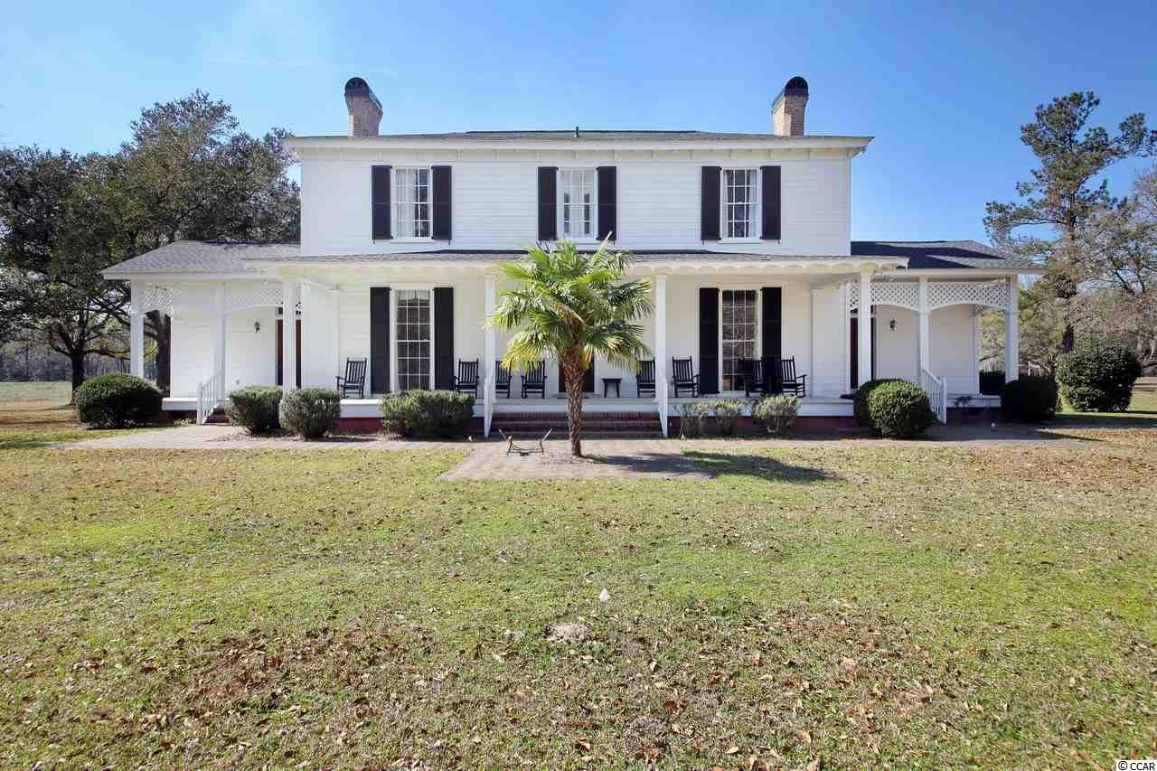 Literally a once in a lifetime opportunity to own one of South Carolina's most historic properties, Beautiful Holly Grove Plantation. This is a must-have for the discerning buyer searching for a historic property with fresh and saltwater access, close enough to town and beaches but far enough away to ensure complete privacy. Circa-1800 Plantation House in immaculate condition, workshop/sheds, garages, recreational building, boat dock and boat ramp providing direct access to the Great Pee Dee River. +/- 350 Acres Acres of cleared land and timber, plus a 235 acre Conservation Easement. All measurements and features listed are approximate and not guaranteed.
