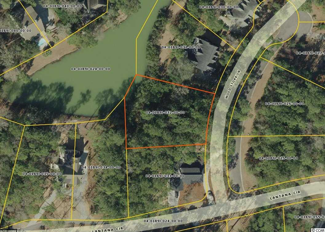 """This beautiful lakefront wooded property is on a protected cul-de-sac in the very attractive Lantana Circle neighborhood, home to many year-round Debordieu residents.  Specimen live oaks distinguish this parcel, which located in the 'X' zone.  The """"X"""" zone designation provides eligibility for exemption from federal flood insurance requirements and allows maximum flexibility in construction options.  Additionally, this property benefits from Debordieu's lowest annual beach renourishment assessment rates.  For boaters, fishermen, and nature enthusiasts, this location affords easy access to one of the largest and most pristine estuarine environments in the United States.  While minutes away from all of Debordieu's many amenities, including spectacular golf, tennis, and beach, a newly-constructed fitness center, and multiple dining options, the Lantana Circle neighborhood enjoys a sense of privacy.  Only recently offered to the market, this property will appeal to discerning buyers contemplating a vacation or year-round residence in Debordieu."""