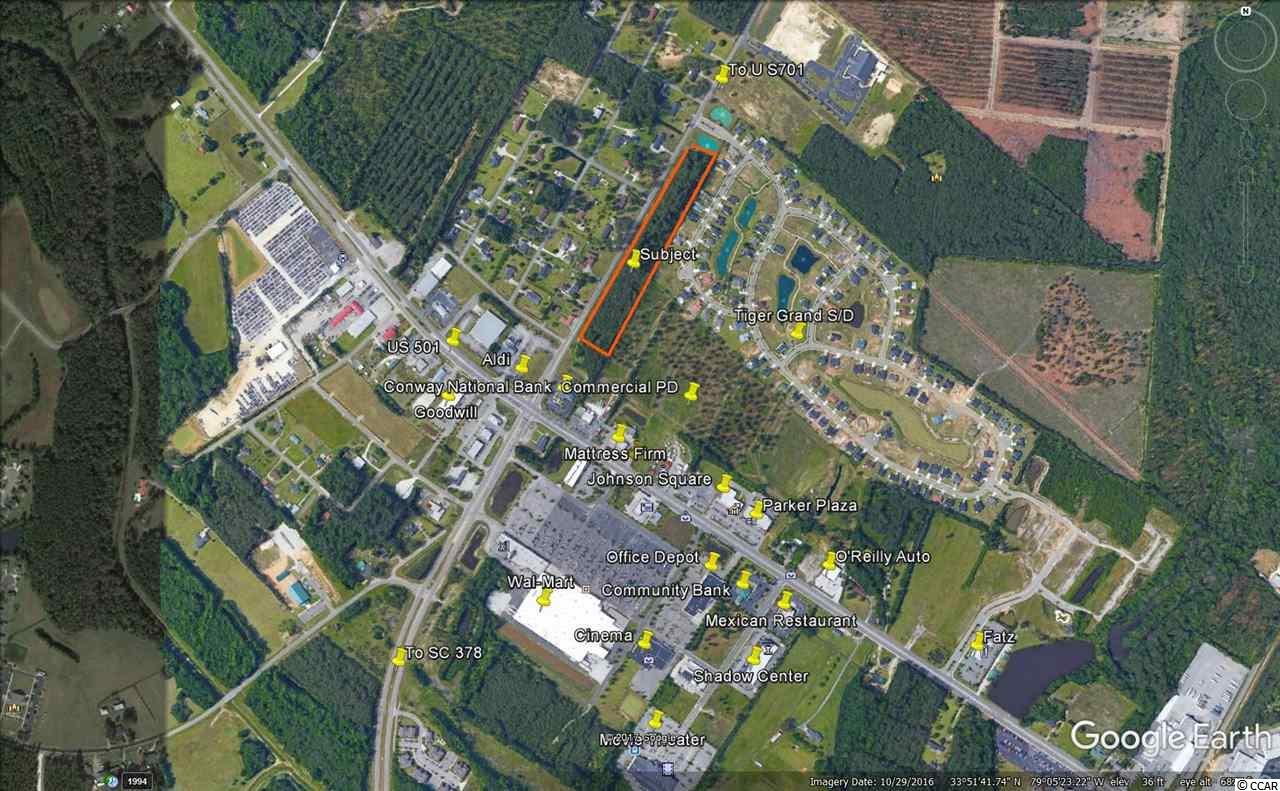 3.6 acre parcel adjacent to Tiger Grand subdivision.  Convenient to area retail restaurants and professional services.  Re-zoning candidate for medium or high density residential development.  Conceptual site plan proposes 16 single family parcels.  All utilities in place.