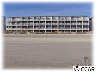 LOVELY DIRECT OCEANFRONT 1 BEDROOM 2 BATH 2 LEVEL CONDO. UNIT  HAS TILE ON LOWER LEVEL FROM FRONT DOOR TO SIDING GLASS DOOR.  UPSTAIRS IS THE MASTER BEDROOM AND MASTER BATH WITH TILED SHOWER. THIS UNIT HAS TWO 8 X 12 OCEANFRONT BALCONIES , 1 FOR SUN BATHING, SIT ON  BALCONY OFF OF LIVING ROOM AND WATCH THE BIG BLUE ATLANTIC ROLL IN AND FANTASTIC VIEWS OF THE WINDY HILL BEACHES. BUILDING HAS  LARGE POOL AND 2 SUN DECKS,  ALSO HAS A RED MEDAL ROOF.