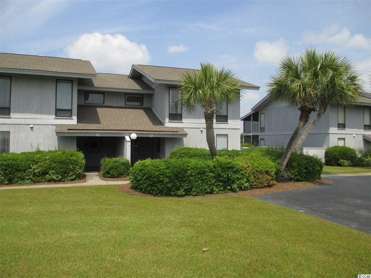 This beautiful 3 bedroom condo is located on the marsh/inlet within the gates of Inlet Point at South Litchfield Beach. The villa features ground level entry for easy access. First floor features living space with an open floor plan including newly remodeled kitchen, large dining and spacious living area....plus a full laundry room, screened porch, patio and 1/2 bath. Three spacious bedrooms and 2 baths are located upstairs with two featuring private decks/porches overlooking the the salt water marsh. Enjoy beautiful marsh and sunset views while only being a short walk to one of the best beaches in South Carolina. Additionally Inlet point features two pools, club house, playground, and dock on the creek.  All info and dimensions should be verified by Buyer.