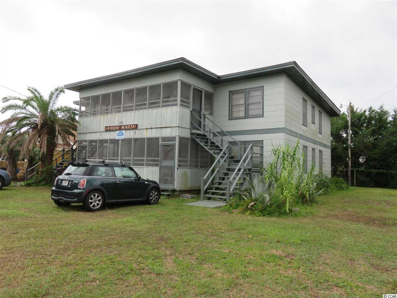 Close to the BEACH, large lot, 4 2 bedroom, 1 bath apts., screen porches , pine panel walls and ceiling, a/c units per apt., rented in the summer months some spring and fall.  Needs TLC.  Call to show.