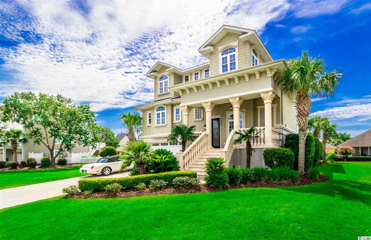 Paradise in Sunset Harbour! One of the most sought after water front communities in North Myrtle Beach! 4 Bedroom and 4.5 Bathrooms. 2nd row from the ICW with waterway views. Beautiful home! Call this exclusive neighborhood yours with this extravagant custom home which boasts Brazilian hardwood floors, granite counters, two living areas, wet bar and so much more. Elevator, Expansive decking and Open floor plan makes it great for entertaining and seller has converted garage into a huge media room with endless possibilities but can be converted back easily. Waterfront community pool, club house and boat ramp! Don't miss out on this beautiful property, only moments from the ocean and beaches by boat or car!!! LOCATION LOCATION LOCATION!!!   Buyer responsible for verification of square footage and measurements.
