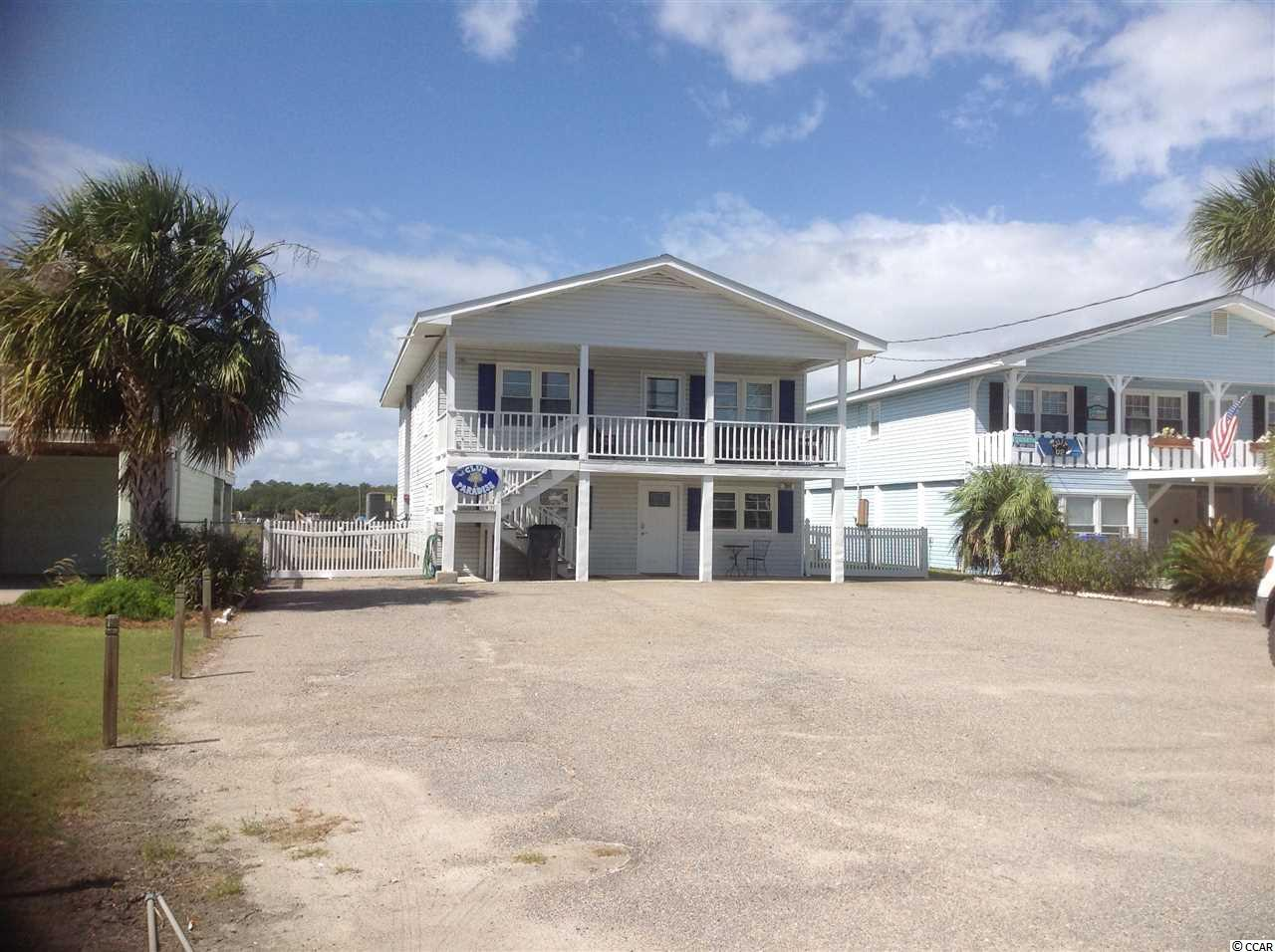 Beautiful 2-story Creek front home in Garden City beach! Enjoy marsh view sunsets from your back deck or pool terrace; watch the sunrise over the ocean from your front porch! This is a fantastic opportunity to own a piece of paradise! This 5 bedroom home is being sold furnished, all that is missing is you and your suitcase. The home offers 2 living areas, 2 kitchens, a rec room, 4 bathrooms, sitting and dining areas, porches, decks, a swimming pool, a floating dock on deep water and more. Located a block off of the ocean and just a short boat ride from some of the finest creek front dining Murrells Inlet has to offer. These types of opportunities do not come along everyday! Square footage is approximate and not guaranteed. Buyer is responsible for verification.