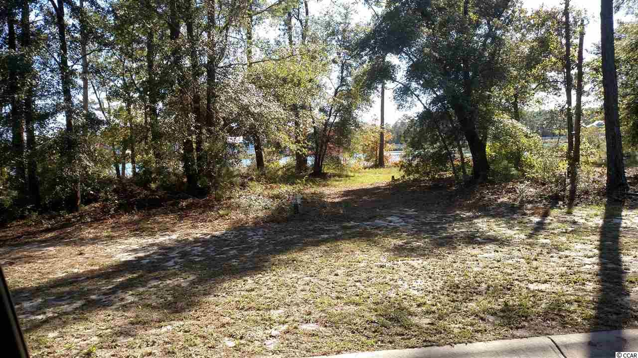 Water front lot available in this prestigious gated community.  Build your custom home on this water front lot.  Act quickly and purchase Lot # 1 for a larger property and water access.  Call listing agent for more information.