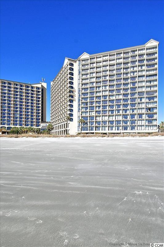 Beautiful Resort in a great location, direct oceanfront condo, with a master bedroom and living room oceanfront balcony. See Virtual Tour. Enjoy as a second home and/or rental property. Resort has everything: outdoor and indoor pools, lazy river, hot tubs, fitness room, on site restaurant, coffee shop, tiki bar, racquet ball court, shuffle board, outdoor grills, covered parking, and lounging pool areas. Great buy!