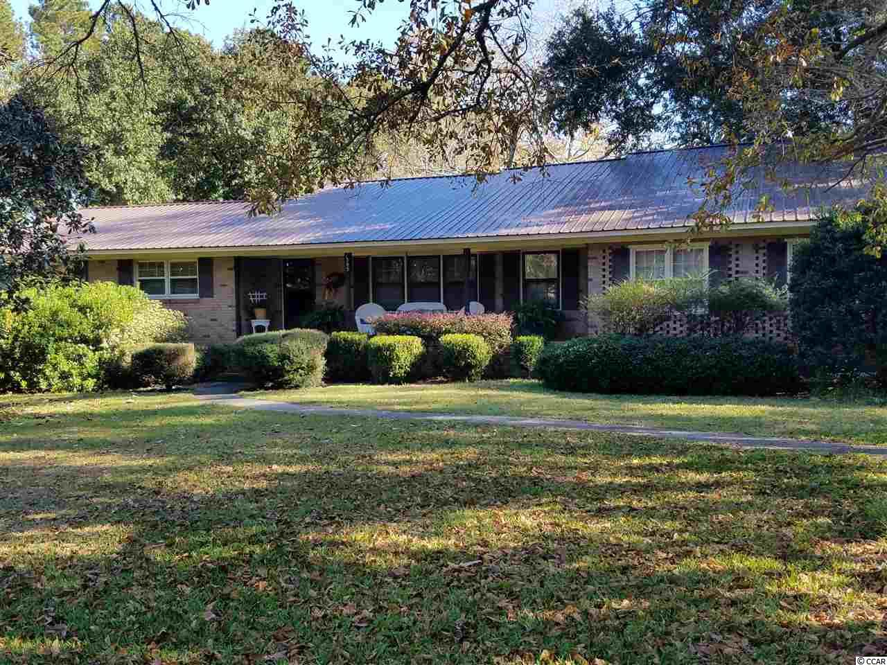 Sprawling Brick Ranch with two master suites, large great room, study, formal dining room, Living room, large closets, wet bar, fireplaces, and more. Fireplace is wood burning with a blower. Located in close proximity to Downtown Conway and Myrtle Beach. Don't let this custom home pass you by.