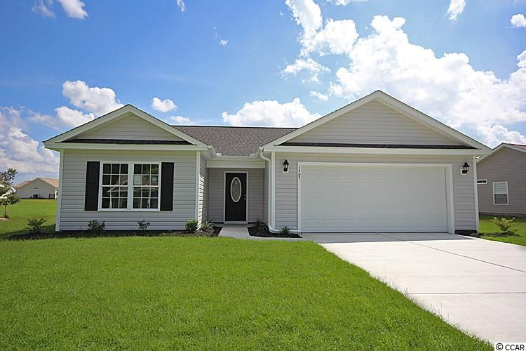 "This Beautiful ""Live Oak"" Plan is in The New Woodland Lakes Community in The City of Conway, SC. Features include but are not limited to 3 Bedrooms 2 Baths, 2 Car Garage, Great Open Floor Plan, Vaulted and Trayed Ceilings, 2 Ceiling Fans, Plant Shelf, and Vinyl Windows, Plans also include Separate 10' x 14' Concrete Patio, Sidewalks to Front Entry and Driveway. All of the Homes in Woodland Lakes Community come standard with the luxury of a Tankless Hot Water Heater, Gas Heat, Gas Stove and Oven. These new Homes also include 36"" Profiled Kitchen Cabinets with Top Molding Trim and Door Knobs, Stainless Steel Appliances, Kitchen Pantry, Linen Closet, Completely Trimmed and Painted Garage with Drop Down Storage Access, which is Floored for your convenience, and Electronic Garage Door with Remote Openers. ""Low E"" Energy Efficient Windows, Upgraded Insulation Package, Landscaped, Sodded Yard, and so much more.  All of the homes in Woodland Lakes are built with a ""Maintenance Free"" Lifestyle in mind. Woodland Lakes is South Conway's Newest Community conveniently located near Shopping, Medical Offices and Hospitals, Restaurants,  and Schools. The Builder DOES ALLOW CUSTOM HOME CHANGES!  Call or visit us online today and find out why This Builder is The Areas Premier Local Builder! Other Floor Plans, Inventory Homes and Custom Plans are Available. Call the Onsite Model for New Homes Availability and to make an Appointment to see Woodland Lakes."