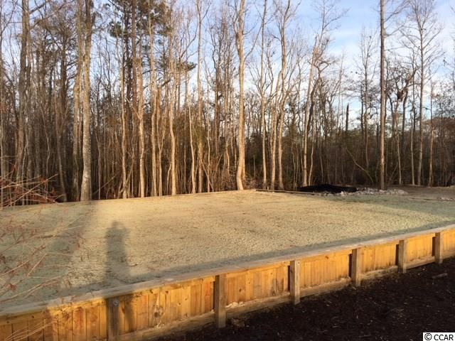 Vacant lot available on the widest part of the Waccamaw River. Views from both sides of the river. New retaining wall in place and lot is cleared.  Zoned for either mobile or stick built home. Property is surrounded by USFWS Conservation area.