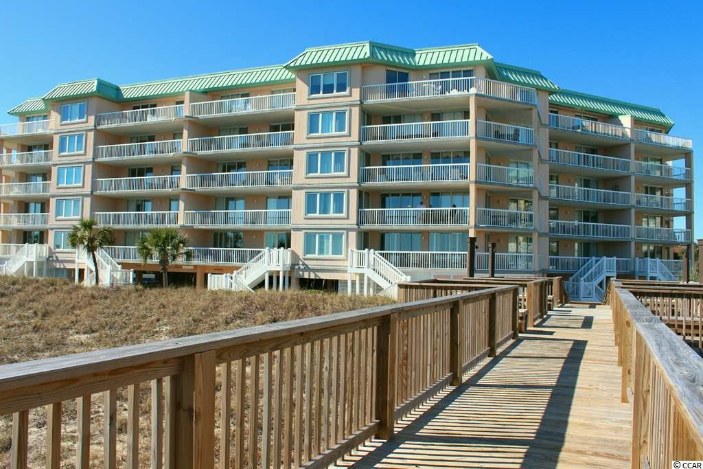 TOP FLOOR - OCEANFRONT! Wonderful condominium in The Warwick, at Litchfield by the Sea, features two bedrooms, two baths and is an end unit with a bay window, extended dining area.  Beautifully furnished throughout, the living area opens to a balcony and fabulous view of the ocean, beach and pool.  The kitchen is fully equipped, and this unit has a wet bar with wine cooler. Master suite also opens to balcony and has a walk-in closet, master bath has garden tub and shower. The Warwick is located in the Somerset community of Litchfield by the Sea and enjoys the premier resort amenities including pools, hot tubs, lighted tennis courts, creek dock, fishing lakes, fishing pier and over 7 miles of walking paths. This unit has a reserved parking space underneath the building, and there is elevator access to all floors.