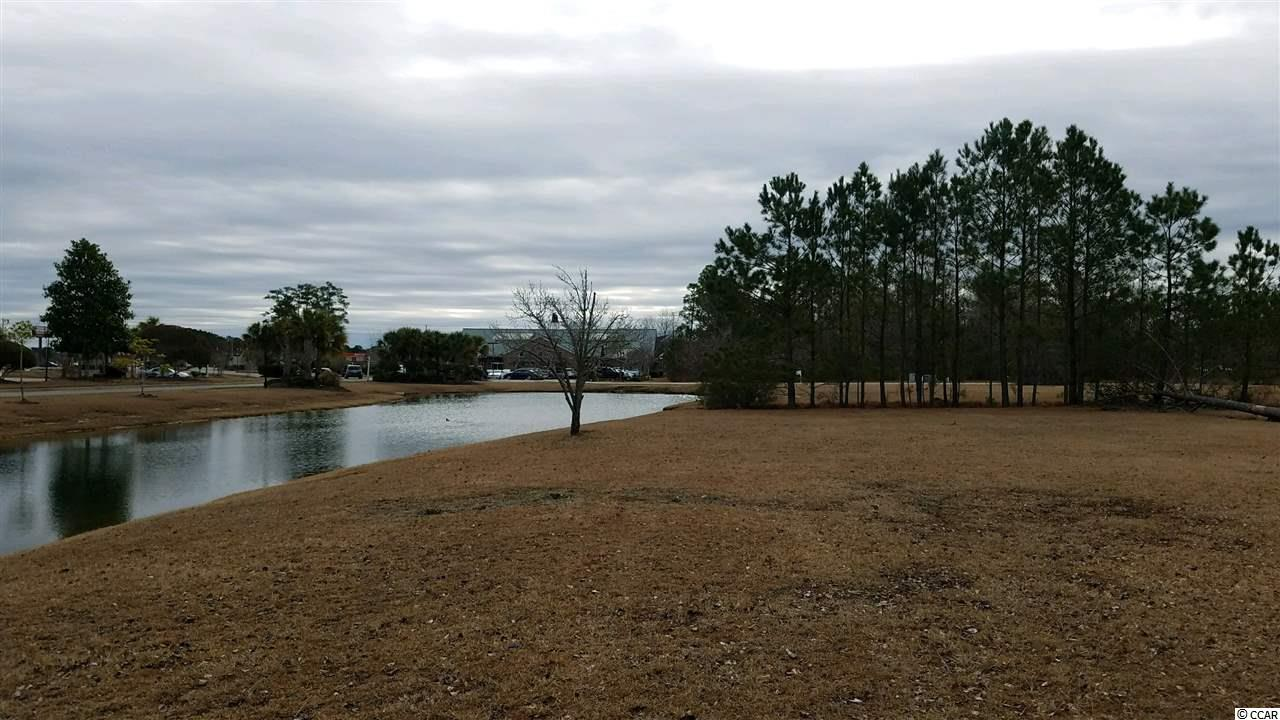What an ideal location for your new business. Queens Harbour professional park is centralized between high traffic commercial and single family residential. Perfect access in/out from HWY 17 Bypass. 3 miles south of Market Common and 5 miles north of Murrells Inlet. Endless possibilities and space for the commercial space you have been needing (and dreaming of).  Surrounding areas in the same development features many lakes and ponds. Drive by today, signs on the property.