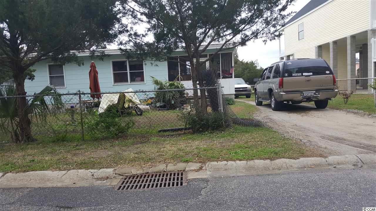 Great Opportunity to knock down and build 1 or 2 properties. This home's large lot is steps to the beach and can be subdivided. Build a rental, 1st or 2nd home and hear the ocean from the front porch. Don't miss out on the great opportunity for beach living or investment.