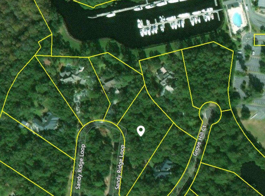 Beautiful 1.45 acre lot located in the prestigious Island Estate section of The Reserve. This amazing wooded lot is one of the few lots overlooking the marina at The Reserve Harbor Club. Island Estates is a gated community consisting of of 33 homesites.
