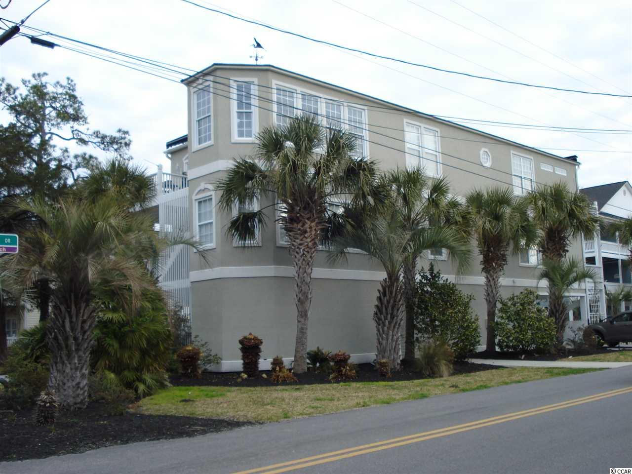 """UNIQUE, UNIQUE BEAUTIFUL CUSTOM BUILT BEACH HOUSE PROPERTY!! This well appointed FULLY FURNISHED house has two self contained units.  Each unit has 2100 square feet. The intercom is convenient for announcing your arrival.  Let's take a tour.....There is ample, convenient parking. Arriving you will see beautiful landscaping and foliage around the lovely pool area with hidden water jets that arch into the pool that is lighted for use at night.  Grilling is necessary to make a day of pool fun with a full dining area by the pool.  There is a half bath within steps of the pool and a hot & Cold water shower facility for comfort, as well.  Underneath the house, beside the pool, is a huge conversation area complete with rocking chairs to relax, TV in a cabinet  and a time to enjoy the wonderful ocean breezes day or night.  Lots of storage areas for beach toys, beach chairs and oh, there is a parking area for your golf cart for a fun, 2 1/2 block drive to the ocean.   let's take the elevator to the top floor unit, owners private unit.  Beautiful 18"""" tiles, crown molding and spacious rooms await your approval.  The Kitchen/dining area has a work island/breakfast bar with lateral cut, top of the line granite counter tops, just like all the other counter tops. All the appliances are stainless steel and there is a matching free standing freezer.  Take time to appreciate the custom, top of the line cabinets. The dining area is large and opens to a very private porch with a retractable cover. Hand selected lighting through out the entire 2100 sq ft unit provides that special touch of class. The great room is complete with a custom corner bamboo, one of a kind, configuration for TV, Fireplace, Surround Sound entertainment.  Through the double French doors you find a beautifully decorated Carolina room with numerous windows on all sides through which you can see the ocean in all its majesty. The master bedroom is very large with double closets and a French door leading to the porch,"""