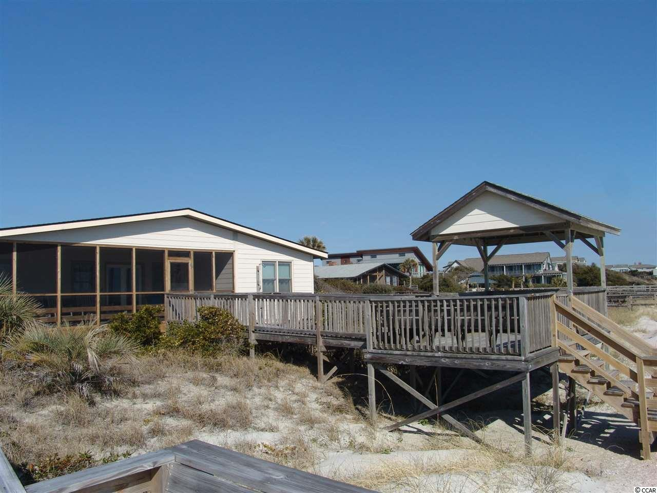 "Located just off the South Causeway, 452 Myrtle Avenue is right in the middle of Pawleys Island.  A great location situated Ocean Front with private drive access and ample parking behind house.  This beach home is a perfect, ideal beach property with five bedrooms and three full baths. The exceptionally large family room provides spacious living for the family and guest to watch television while others have ample room to particiapte in other activities. The kitchen is a nice size with bar seating that is adjacent to large dining area and kitchen table that will seat numerous family members and friends. Central heat and air, ceilling fans, dishwasher, microwave, disposal, washer and dryer, cable TV""s, DVD, sofabed, ocean and rear screened porches with deck on dunes and outside shower and grill all make this home an exceptional beach property and value.   Excellent rental history !!!  This home is in excellent condition and has always been well maintained by owners.  The Beach House features both front and rear screen porches and a private boardwalk and covered ""Look Out"" to sit and enjoy the sun rise, sun set and enjoy the ocean  and amenities of Ocean Front living.  Truely a home to build memories at the Beach!!!!"