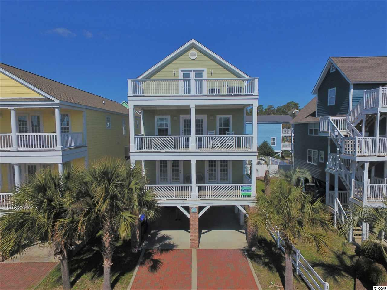 """Welcome to your very own """"Beach Oasis!""""  This 3-story, 6-bedroom, 6.5 bathroom beach home is located in the quaint town of Surfside Beach just south of all the shopping, dinning and entertainment Myrtle Beach has to offer!  This home features 2,500+ heated square feet with an inverted floor plan which has a large open living, dining and kitchen area.  Step out on to either of the first or second floor covered porches or 3rd floor open balcony to capitalize on the wonderful view!  A private pool and elevator give this home extra amenities to make it a great rental property.  Contact the listing agent, or your Realtor, to arrange a private showing."""
