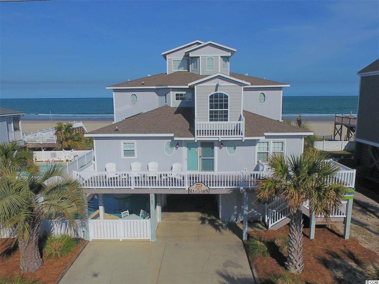 """Welcome to your new """"Sea Clusion"""" at the beach.  This 7-bedroom, 5-bath beach home sits on one of the premier large 72' wide oceanfront lots on the South-end of Garden City Beach, South Carolina.  This home underwent a major renovation in 2016 and has had a major price reduction!  During the renovations, the flooring was replaced throughout the entire house.  The kitchen and bathrooms were completely gutted.  The sheet rock, insulation, electrical, plumbing and interior doors were replaced on the first two floors (top two floors were added in 1995 to maximize the full 40' county height restriction).  All furniture was replaced and picked out my a professional interior decorator.  A private heated pool helps generate great rental income and makes this house an excellent investment property.  This beach home is in immaculate shape and ready for a new owner.  Contact the listing agent, or your Realtor, to set up a private showing.  To see the 3-D Virtual Tour, click the following link: https://my.matterport.com/show/?m=jGLDj9VAALC&brand=0"""