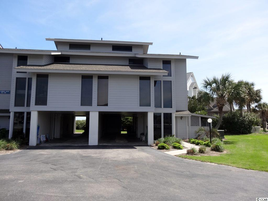 Welcome to the oceanfront, gated community of Inlet Point in Pawleys Island, SC.  Oceanfront, updated 1/2 deeded interest share of a 4 bedroom, 4 bath condo in desired community with 2 swimming pools, boat ramp, uncrowded beaches, and community dock over the marsh.  This condo boasts 2 screen porches for remarkable beach and ocean views, deck for sunbathing or enjoying the ocean breeze.  Large great room with plenty of seating, giant flat screen, and wet bar.  Kitchen with plenty of counter space and breakfast bar and dining area with room for eight. Master bedroom with vaulted ceilings and loft space.  Each bedroom has it's own full bathroom as well.  Close to causal and fine dining restaurants, shopping, and golf courses.  20 miles to Myrtle Beach, 12 miles to Georgetown, and 70 miles to Historic Charleston.