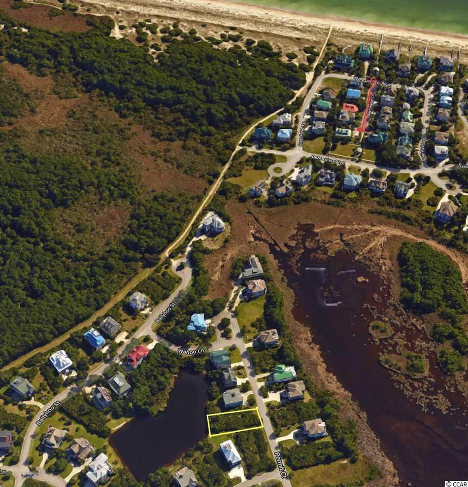 Come enjoy DeBordieu living and build the beach home you've always desired on this lakefront homesite in the Ocean Oaks neighborhood.  With over 70 feet of lake frontage and possible marsh views, this spot could easily be your favorite retreat.  Property owners in this neighborhood enjoy easy access to the beach via a golf cart trail easement.  DeBordieu Colony is a very private, oceanfront, gated community located near Pawleys Island, South Carolina on the coast between Charleston and Myrtle Beach. The onsite private DeBordieu Club offers amenities such as golf, tennis, and multiple dining options to DeBordieu Club members and guests. Natural amenities include miles of beach and tidal creeks, an on-site nature preserve with walking trails and bike paths, and a delightful year round climate.