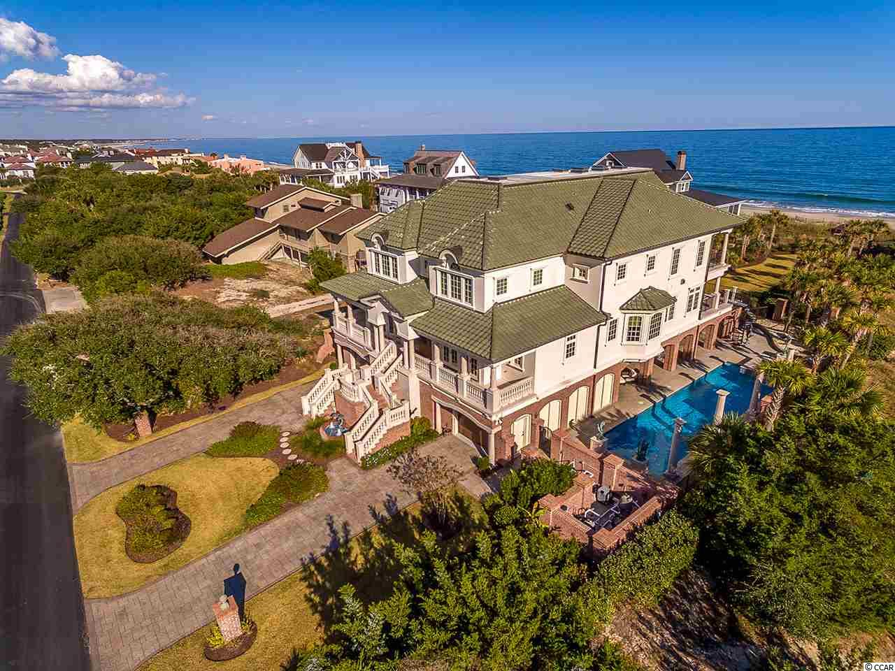223 Pioneer Loop – Featuring the finest in oceanfront living in DeBordieu Colony. This custom-built home offers 5 bedrooms, 6.5 bathrooms and is masterfully designed sprawling over 15,000 sq. ft. Everything is custom with an emphasis on excellence and coastal charm. Property highlights include: black walnut flooring, central vacuum system, custom alder doors, security system, whole house surround sound, 3 fire places, geothermal salter water pool (heated), whole house generator...just to name a few.   DeBordieu Colony is an oceanfront community located just south of Pawleys Island, South Carolina featuring private golf and tennis, saltwater creek access to the ocean, a manned security gate, and luxury homes and villas surrounded by hundreds of acres of wildlife and nature preserves.