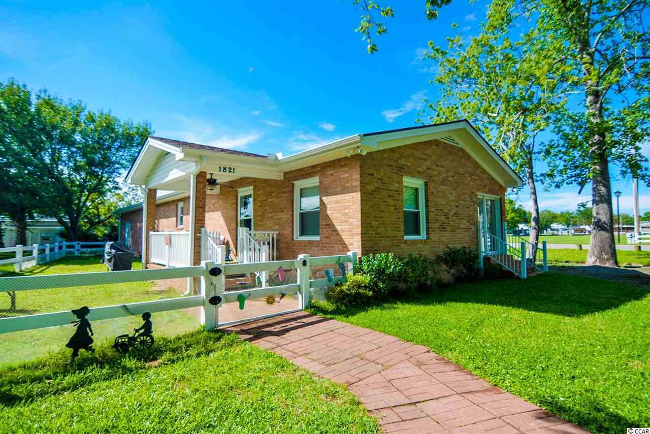 FULLY FURNISHED single level 3 bedroom 2 bath beach bungalow nestled on an large corner lot with BRAND NEW DRIVEWAY in the heart of Surfside Beach ! Set along the coast of pristine sandy beaches and proudly named '' THE FAMILY BEACH'' This bright and unique brick home has everything you need to come and enjoy the Grand Strand ! If investment is what you seek this beach charmer is ready to rent today all your guest needs is a toothbrush ! 1821 Egret is tastefully decorated with coastal decor and boasts wood floors throughout for easy beach clean up, an updated kitchen/ appliances, and large bedrooms with split bedroom floor plan. Step outside and there's an attached storage, fenced in yard, picnic table and seating area right out front and large front porch and beautiful water views! Perfect for enjoying those Carolina sunsets and a great opportunity to kickback and relax or fire up the grill. DID I MENTION THE HOA HANDLES THE YARD WORK ? Oceanside Village is located on a 180 acre oceanfront gated resort with PRIVATE BEACH ACCESS and PARKING LOT directly in front of the beautiful ATLANTIC OCEAN ! Owners at Oceanside Village enjoy both indoor and outdoor pools perfect for anytime of year, children's water park, fitness center, volleyball, tennis courts, baseball, pickleball courts, dog park and so much more ! Close to the Myrtle Beach International Airport, shopping, Murrells Inlet Marsh walk, Brookgreen Gardens, Murrells Inlet Outpost, Garden City Pier, Conch Cafe, Wild Water and Wheels, Market Common, Myrtle Beach State Park, Myrtels Beach International Airport and all Myrtle Beach has to offer. The only thing missing is you and the memories you'll create !