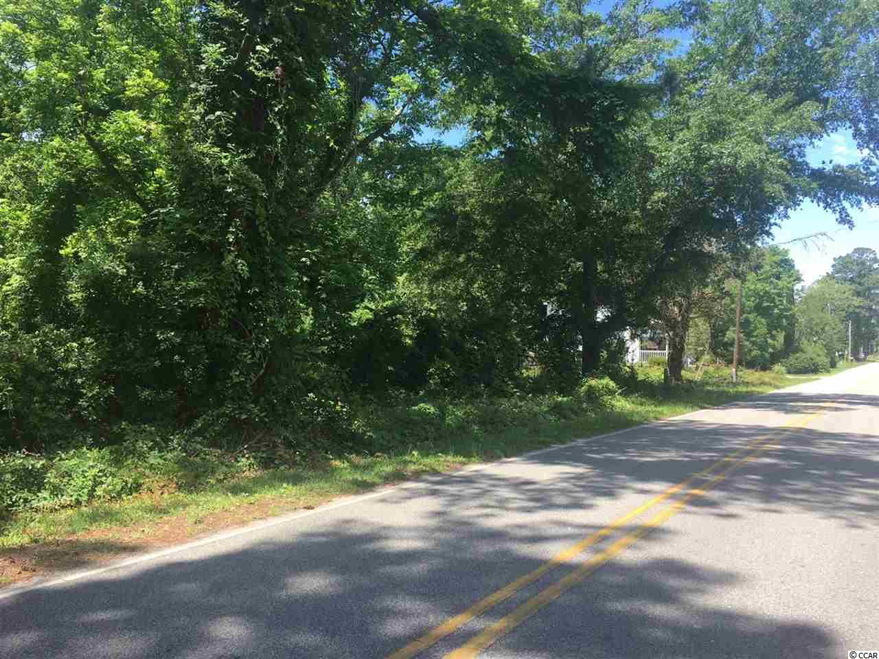 Nice sized lot with many possibilities.  Had been partially cleared at one time. Come build your dream home!! Located East of Hwy 17 Business-- NO HOA!!!! Public access to the Murrells Inlet Creek just at the end of Stanley Drive.   ( 75x155 )