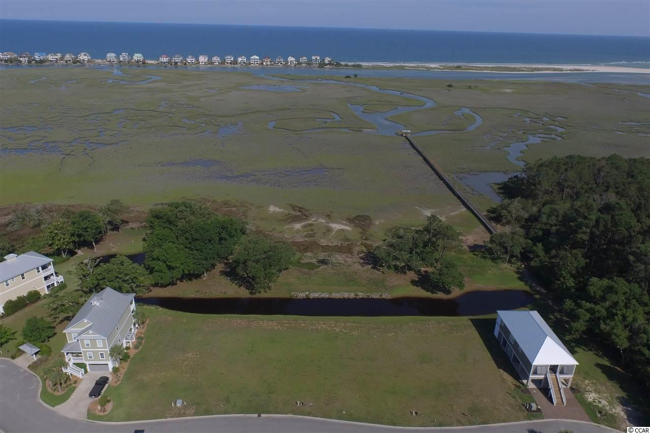 Watch the sun rise on Litchfield Beach. This lot is possibly the best in the community.  Nice ocean views.  Overlooking the beautiful saltwater tidal creek and the south end of Litchfield Beach. Gated community with dock and pool. Fishing, crabbing, kayaking, paddle boarding and more right in your back yard. The Enclave consists of single family homes with easy access to shopping, golf, beach, restaurants, grocery and more. Amazing views overlooking this saltwater paradise.